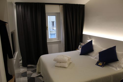 Quarto do hotel Cappello D´Oro em Bérgamo